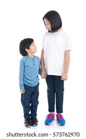 Asian children holding hand together on white background isolated