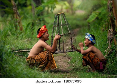 Asian children Indonesia happy friend.Indonesian child laugh fun together friendship.Group friends kid happiness playing countryside Bali.Kids traditional Indonesia culture.Asia children happy concept
