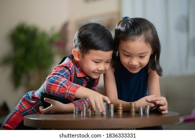Asian children, managing finances, counting money