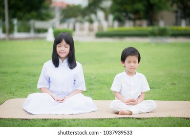 Asian Kids Meditation Images, Stock Photos & Vectors
