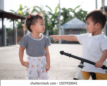 Asian children play together in the morning. Portrait of boy and girl.