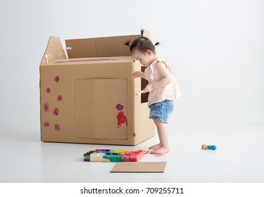 Asian children were painting,drawing on the house made of paper. STEAM education