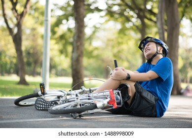 Asian children's knee injury due to falling bike.