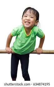 Asian Chinese little girl hanging on horizontal bar in isolated white background