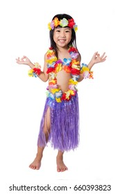 Asian Chinese little girl in hawaiian costume pretending to be a Hula Dancer in isolated white background