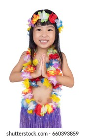Asian Chinese little girl in hawaiian costume in isolated white background