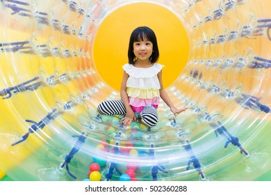 Asian Chinese Little Girl Playing Roller Wheel at indoor playground