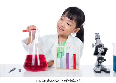 Asian Chinese little girl working with test tube in isolated white background