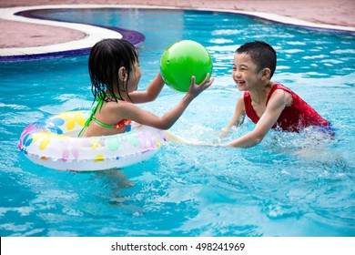 Asian Chinese Little Kids Playing in the outdoor Swimming Pool