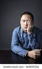 Asian Chinese man, sad and depressed.shot in Studio