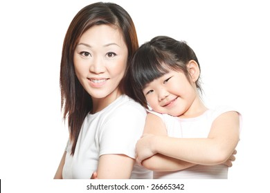 Asian Chinese mother with daughter family portrait shot against white studio background