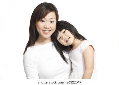 Asian Chinese mother and daughter posing and smiling happily isolated on white