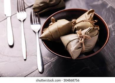 Asian Chinese Rice Dumpling, Zongzi, on Black Background.