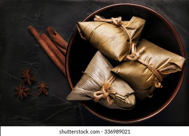 Asian Chinese Rice Dumpling, Zongzi, on Black Background.