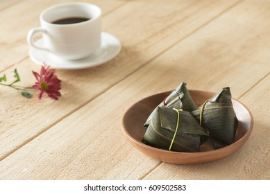 Asian Chinese Rice Dumpling,Zongzi, coffee on the wood board.