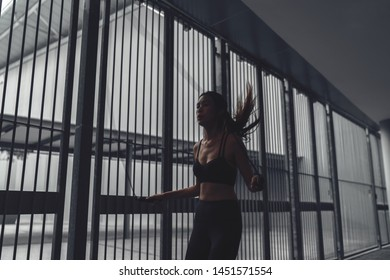 asian chinese woman skipping, silhouette form against grill gate