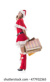 Asian Christmas girl hold shopping bags, full length portrait.