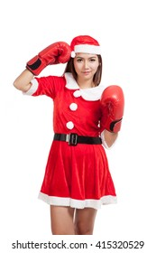 Asian Christmas girl with Santa Claus clothes and  boxing glove  isolated on white background