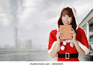 Asian christmas woman holding gift in Hong Kong, Asia.