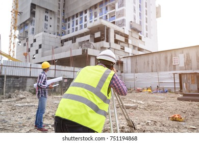 Asian civil engineer checking work for control and management in the construction site or building site of high rise building