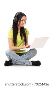 An asian college girl working on the laptop