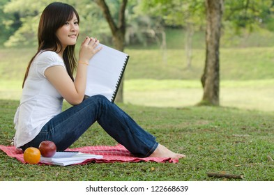 asian college student studying outdoor