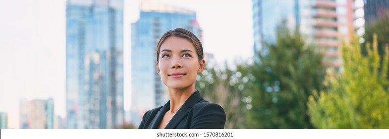 Asian confident business woman looking up to the bright future of her career opportunities. Job, work aspirational banner panorama background. Businesspeople lifestyle.