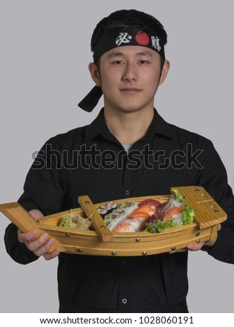 Asian Cook Holding Sushi Japanese Food Stock Photo (Edit Now ... 7bb7788bcee
