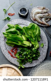 Asian cooking ingredients: rice papper, pok choy, sauces, raw shrimps. Asian food concept Chinese or Thai cuisine