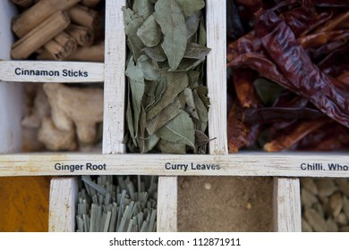 Asian cooking spices in a wooden box.