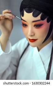 Asian costume Peking opera actor performing makeup
