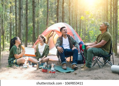 Asian couple camping in their tent on the sunny day;Vacation Concept