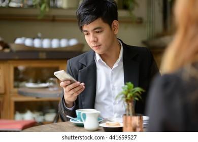 Asian couple coffee shop