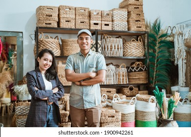 asian couple entrepreneur with crossed hands while in a craft shop with handmade crafts on the shelf background - Shutterstock ID 1900942261