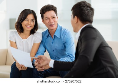 Asian couple at financial planning consultation