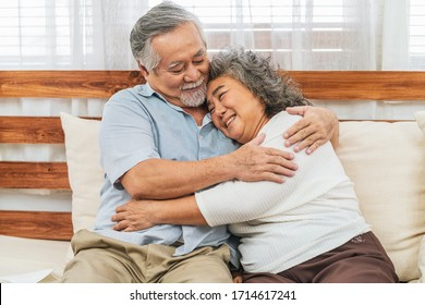 Asian couple Grandparent embracing or hugging together with happy feeling in house, romantic and lover with valentine or anniversary, Long live and Elderly society, Warm family and happiness concept