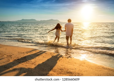 Asian couple are happy with love on the beach at summer weekend holiday.