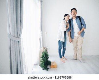 Asian Couple lover moving to the new home.They're exciting and happy.