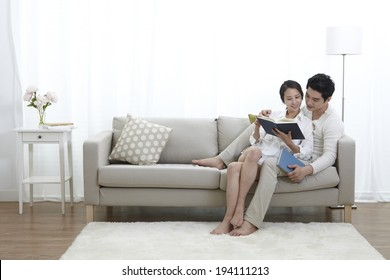 Asian couple reading