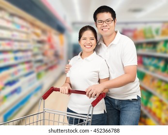 asian couple shopping in supermarket