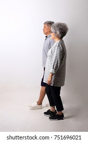 The Asian couple standing on the white background.