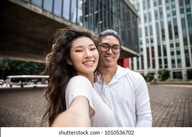 Asian Couple Taking a Selfie