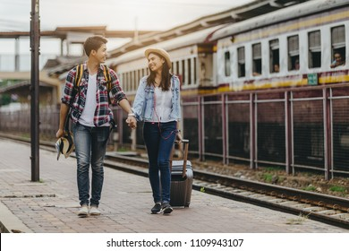 Asian couple traveling train station vintage style concept, in thailand