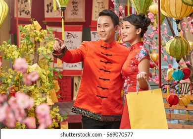 Asian couple walking outdoors on Spring Festival