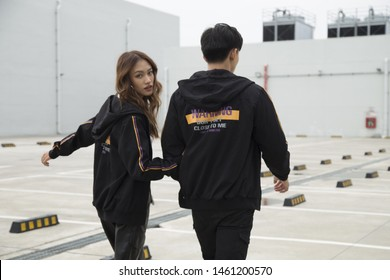 Asian couple walking together in the street, fashion, posing