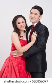 Asian couple wearing evening gown and dress.