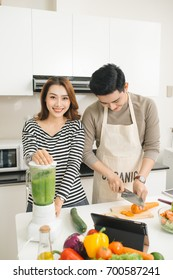 Asian couples lover cooking together in the kitchen at home