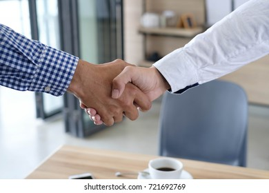 Asian  creative business people shaking hands with colleagues together at meeting time for develop job to success, business colleagues teamwork concept