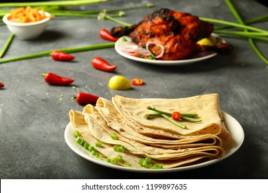 Asian cuisine- chapati,chapathi,or roti served with tandoori meat and salads.