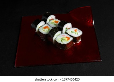 Asian cuisine dish, delicious sushi, sushi on a black background, roll you net on a black background,